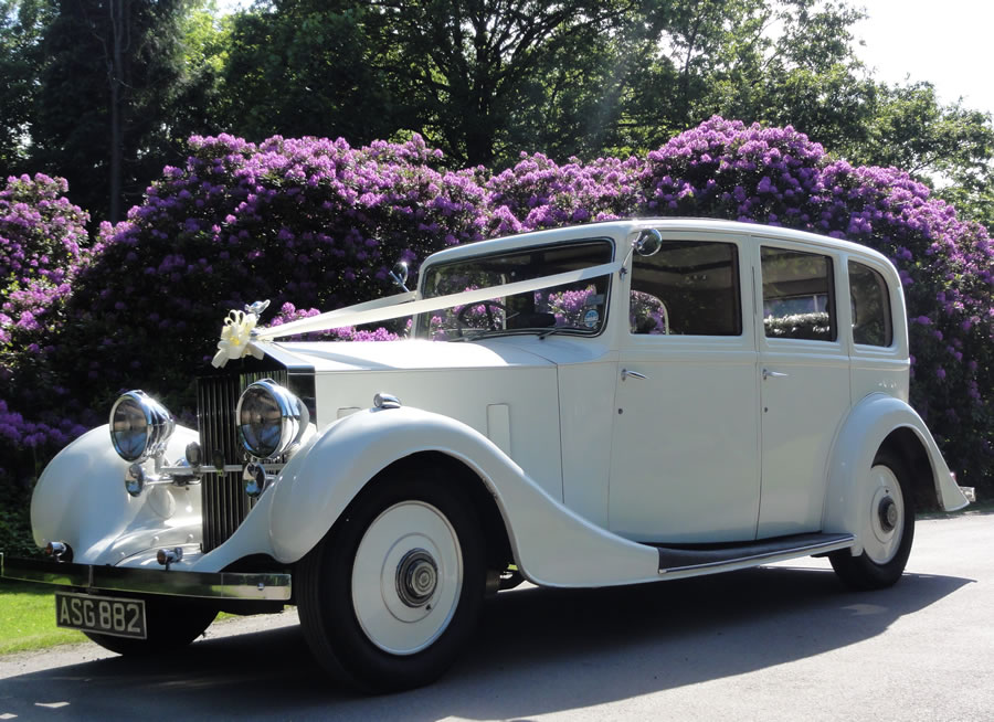 Rolls Royce Wedding Limo Purple Flowers